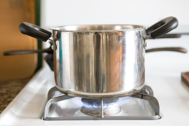 Water boiling on the stove.