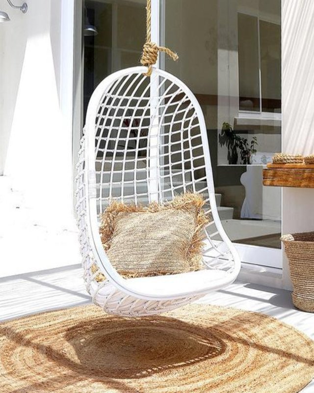 Amber Interiors white rattan hanging chair.