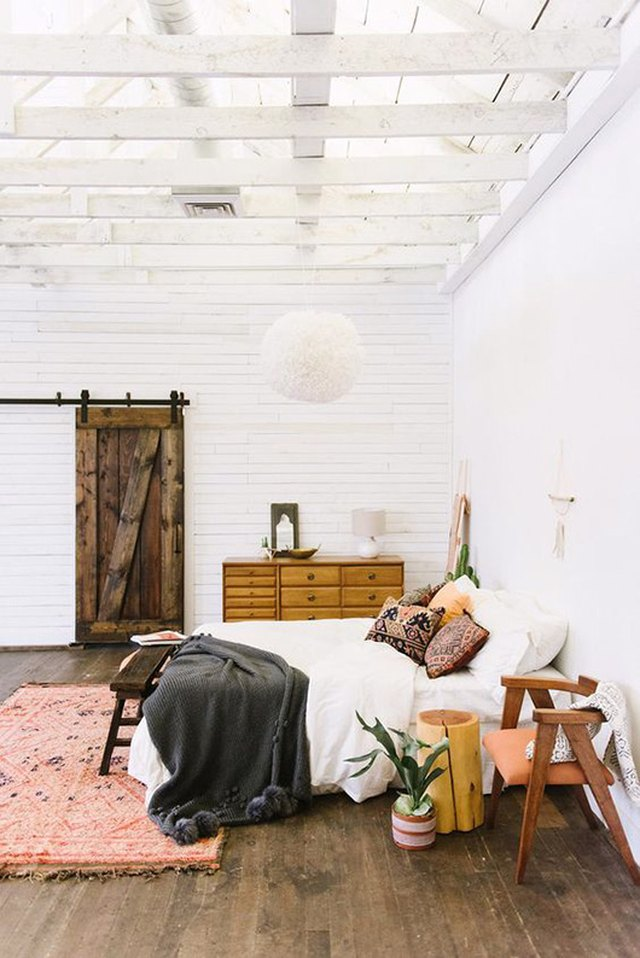 Bohemian bedroom with white-painted ceiling beams