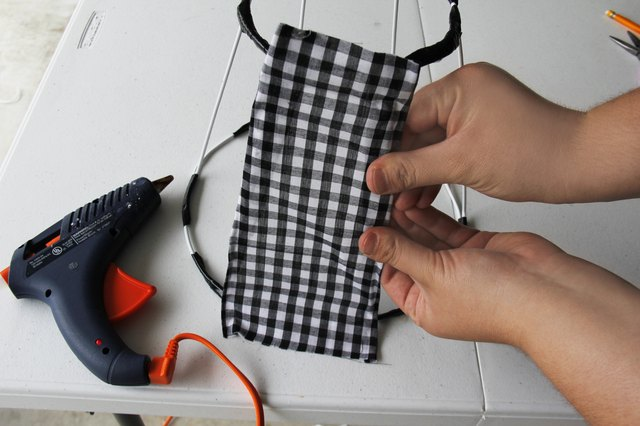 How to make a lampshade from scratch hunker apply hot glue on one vertical wire of the lampshade frame press one side of the strip of fabric on the hot glue make sure keyboard keysfo Image collections