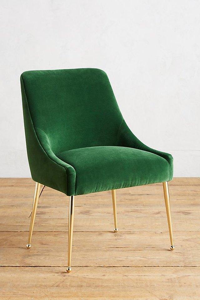 Minimal emerald-green velvet chair with thin brass legs