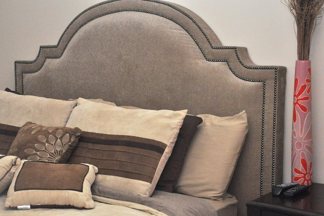 Bed with decorative headboard.