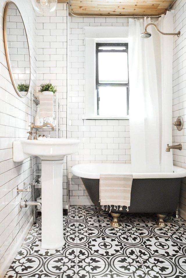 Deck-Mounted Double Handle Widespread Bathroom Sink Faucet in Antique Brass
