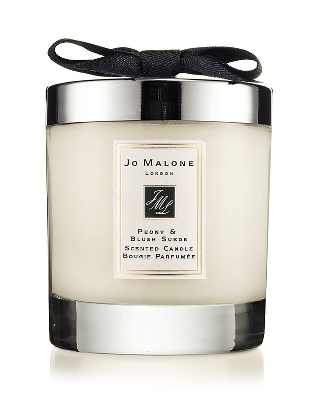 White candle with silver top and bottom