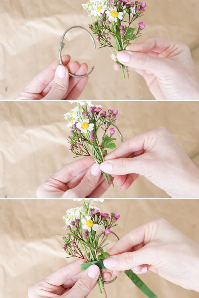 Placing fever few and wax flower on curtain ring