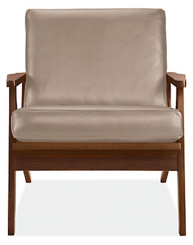 Mid-century armchair with wooden frame and tan leather cushions