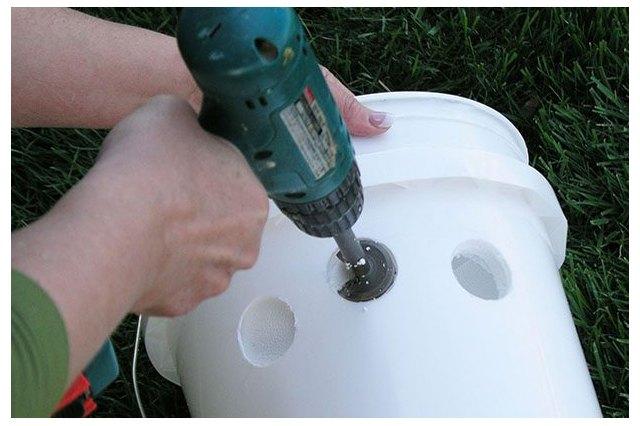Drill holes in the styrofoam bucket.