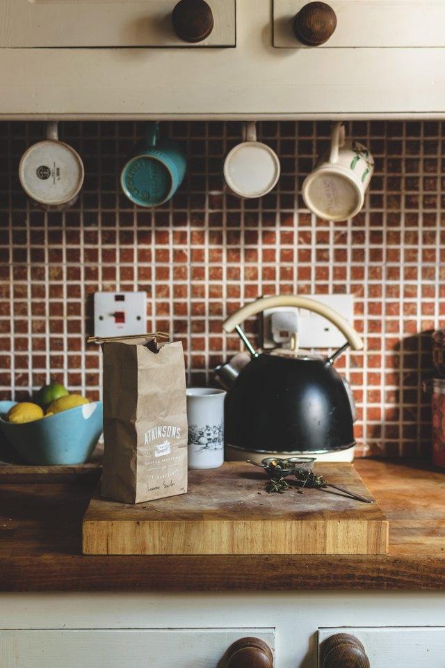 Clean tiled kitchen backsplash.