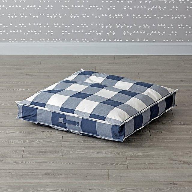 Land of Nod navy floor cushion.