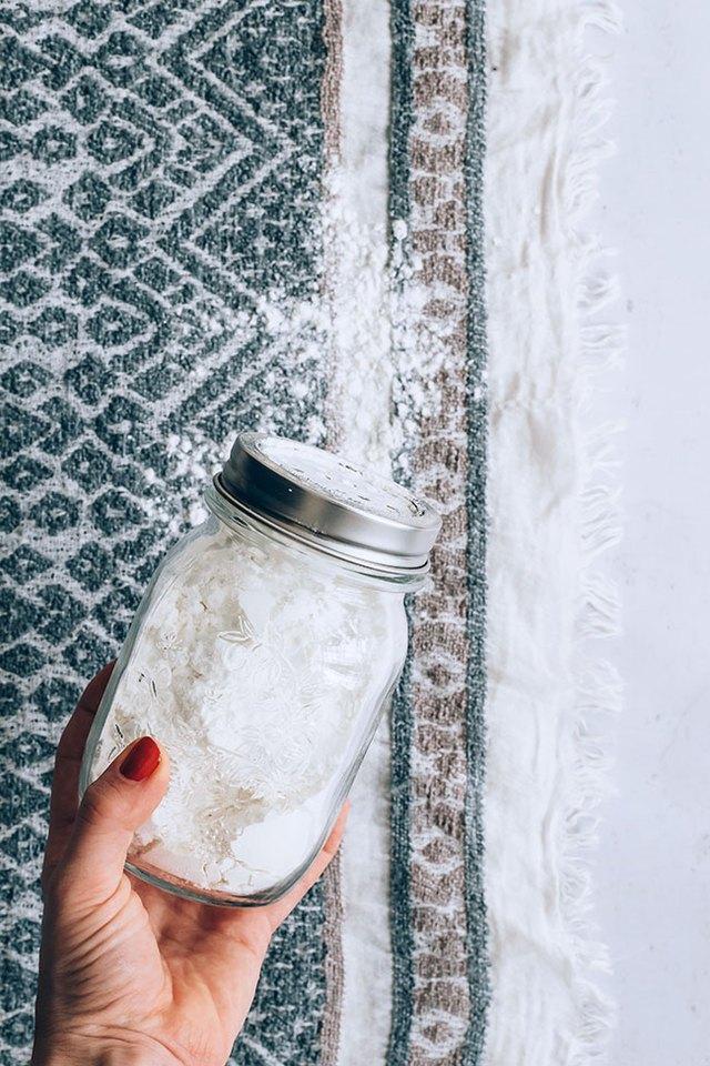 Apply baking soda mixture to carpet