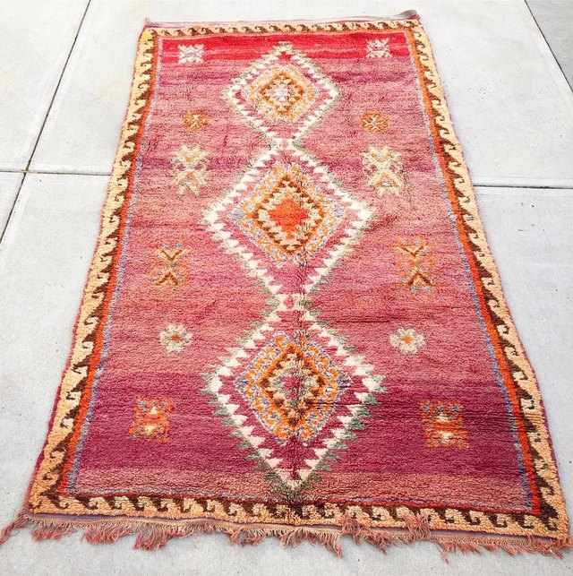 Red and yellow variegated rug