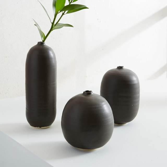Set of three matte black vases with bulbous silhouettes and varying heights