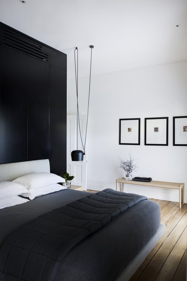 Bedroom with black accent wall.