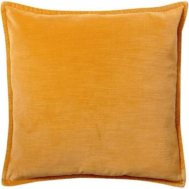 Square velvet throw pillow featuring goldenrod hue