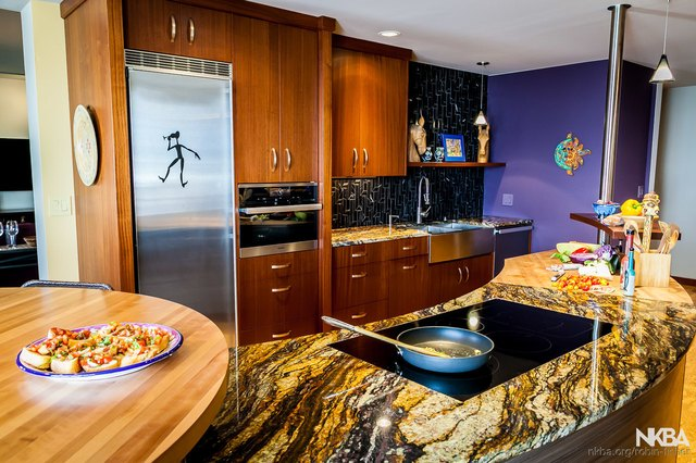A kitchen with a variety of work surfaces.