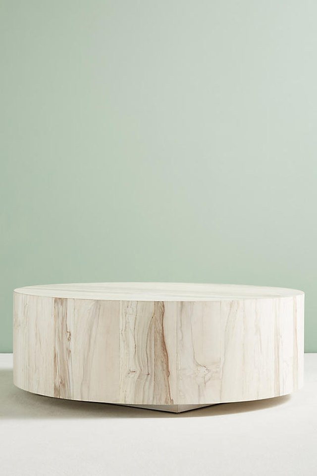Circular coffee table with raw wood appearance