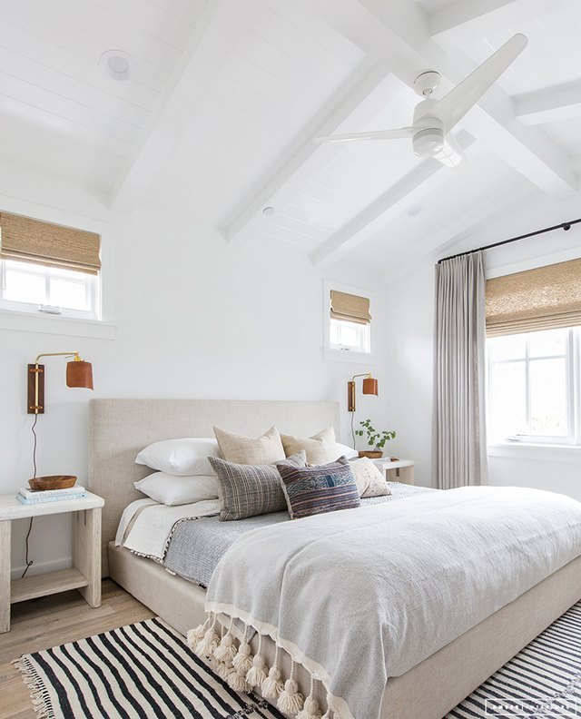 Bedroom with striped area rug