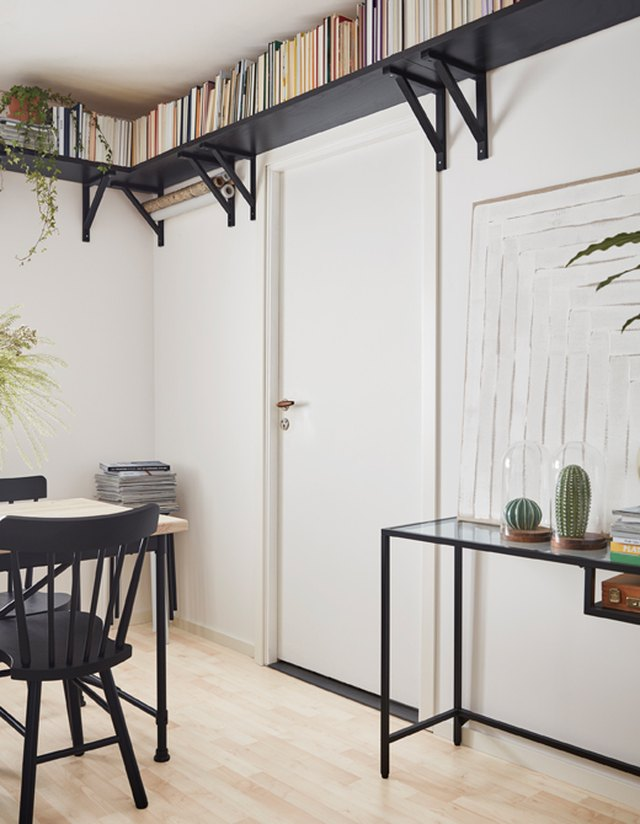 wraparound floating shelves in studio apartment