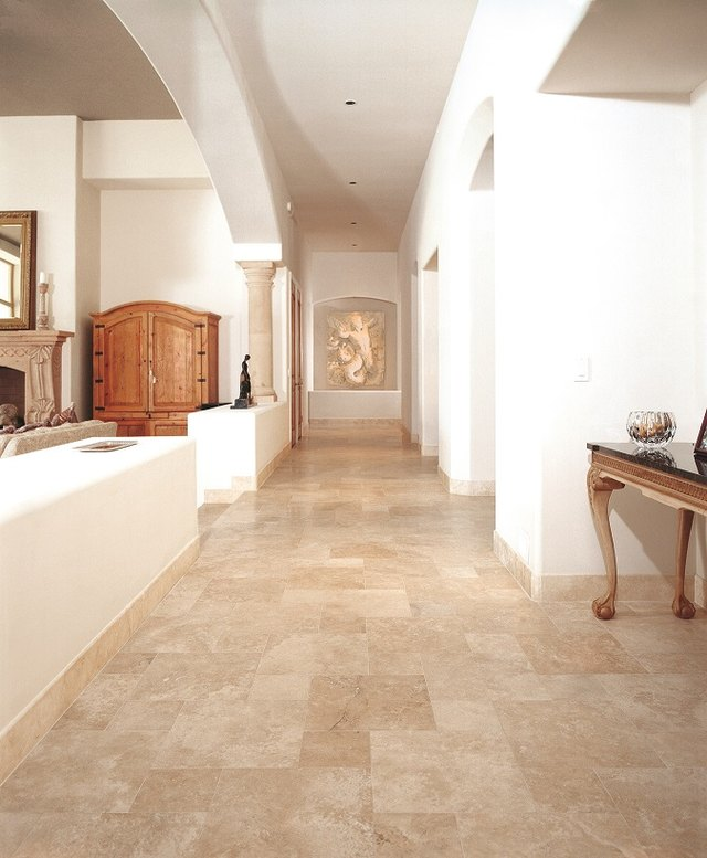 travertine tile baseboards in neutral toned hallway