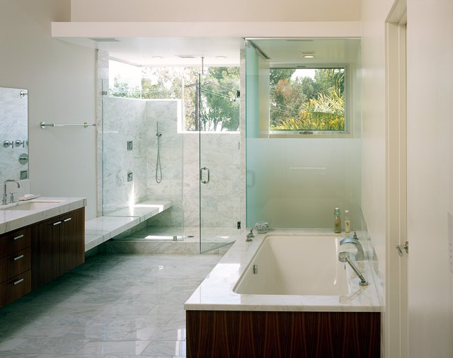 white cultured marble bathroom with glass shower