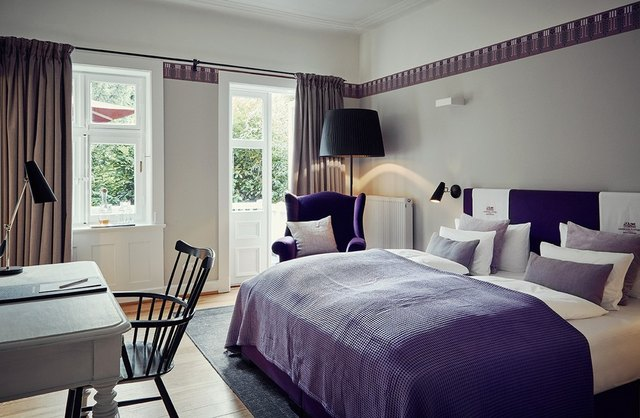 purple bedding in bedroom