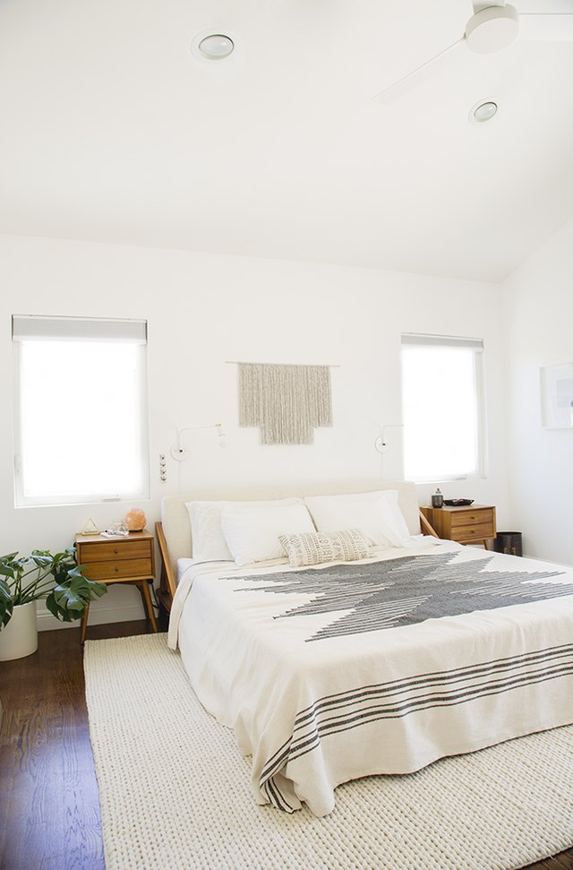 Minimal midcentury bedroom with symmetrical side tables