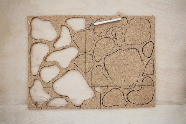 Cutting moss shapes out of cork tiles