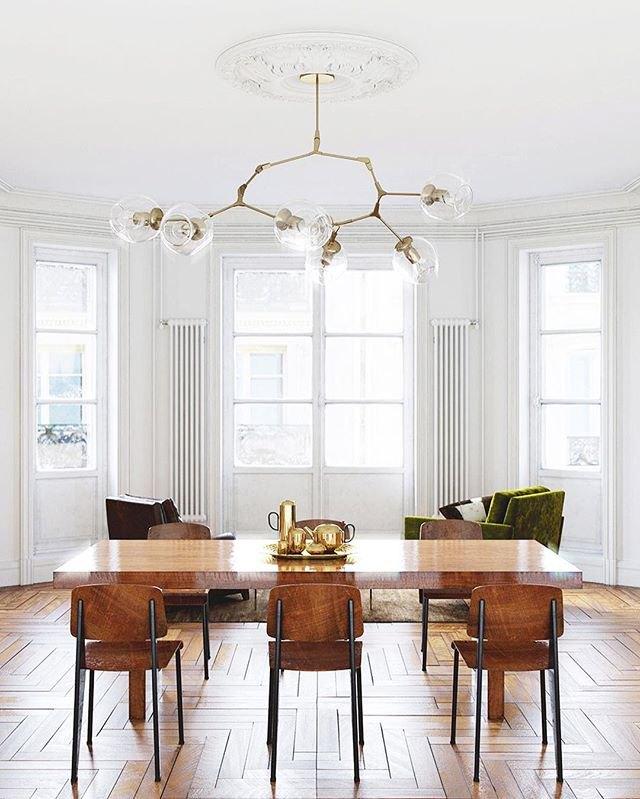 Minimal wood-dominated dining room with sputnik chandelier