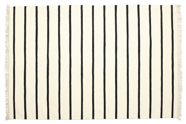 White rug with black stripes