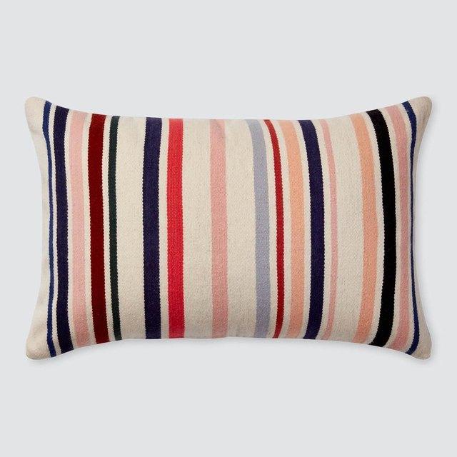 Peach, cream, and blue-striped lumbar pillow