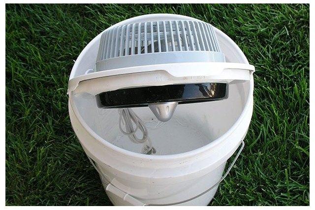Fan placed into lid of bucket.