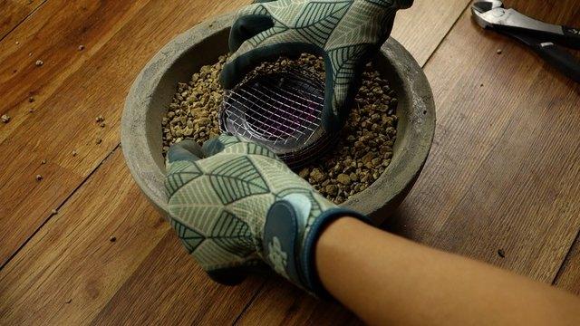 Assembling DIY concrete fire bowl.