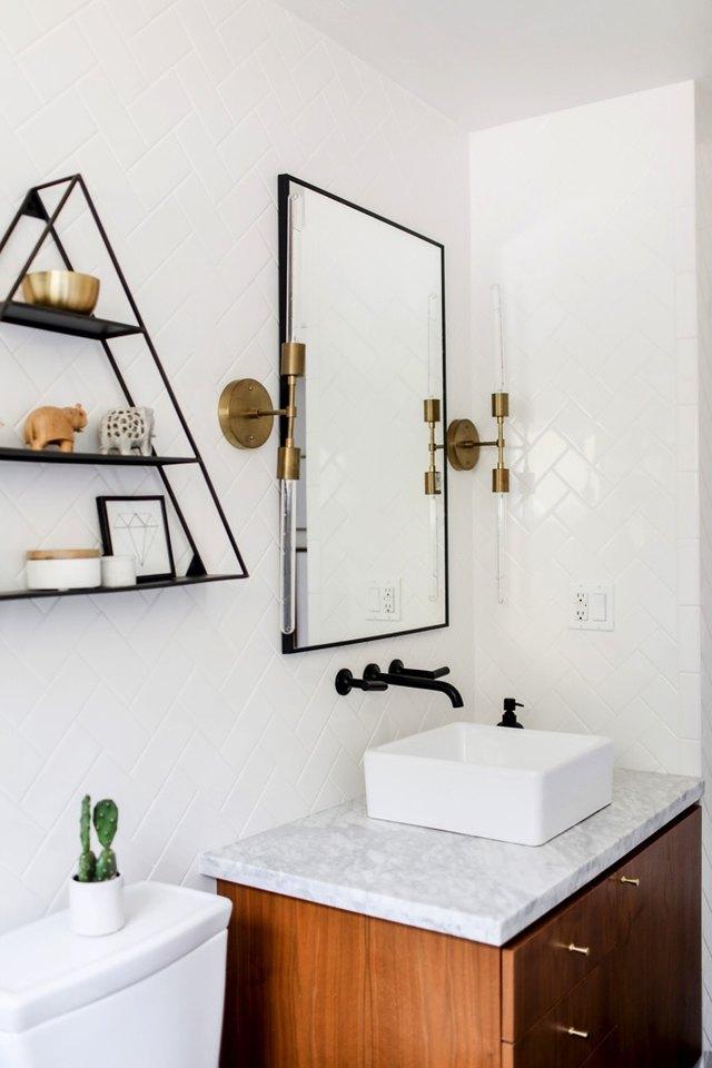 12 brilliant bathroom light fixture ideas hunker install vertical vanity light bars bathroom wall sconce aloadofball Images