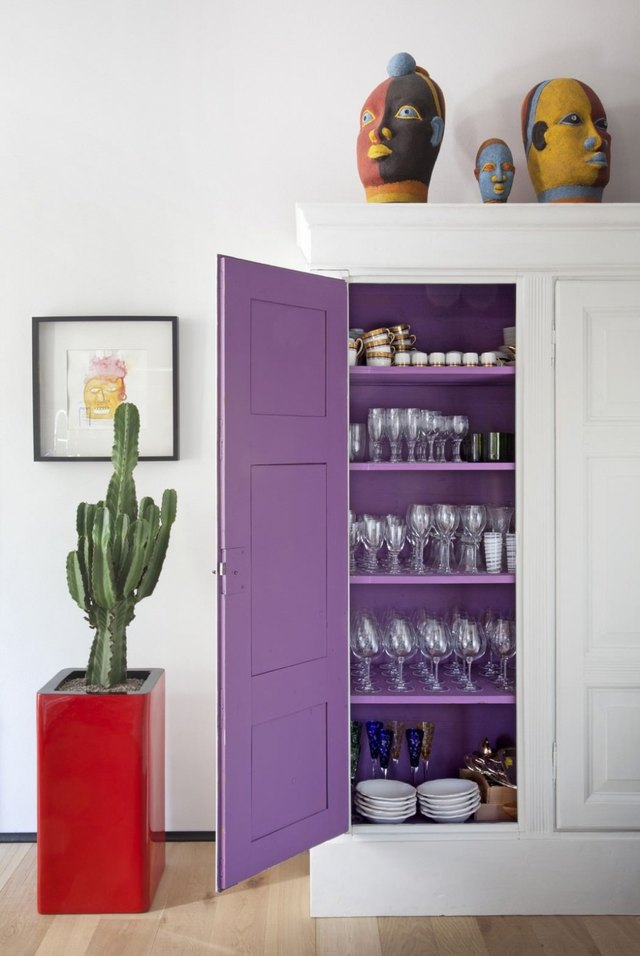 White cabinet with purple painted interior