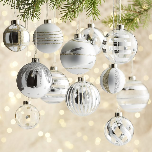 Silver ornament bulbs with various silver glitter designs