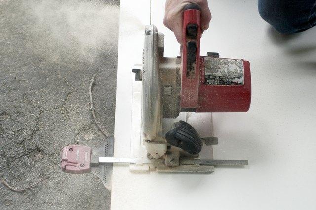 circular saw cutting melamine board.