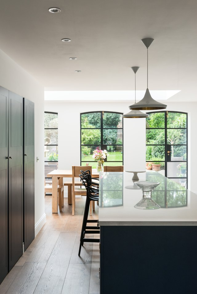 dark blue kitchen vertical hanging lights