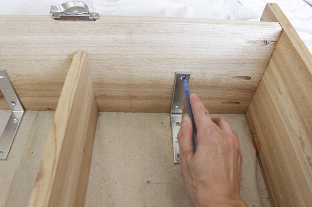 Attaching L backet to inside of box frame.