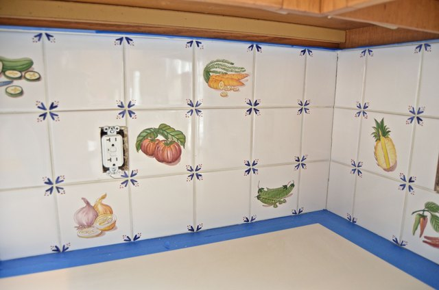 tape off countertop and cabinet