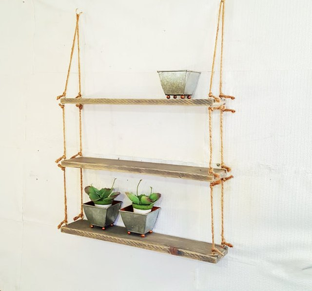 3 floating shelves in reclaimed wood strung together by rope