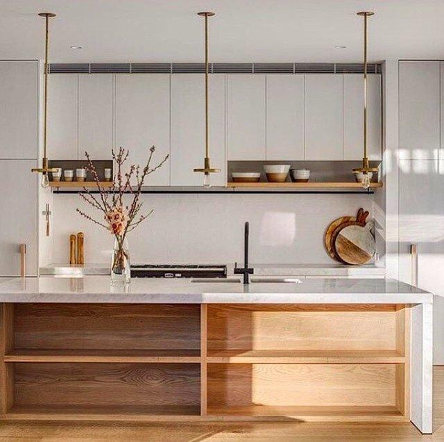 minimal brass exposed bulb kitchen