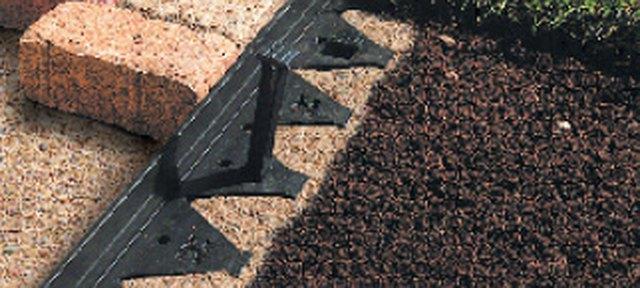 Brick paver with plastic edge.