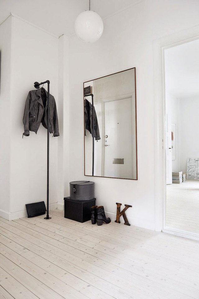 Entryway mirror in the hallway that doubles as a wardrobe mirror.