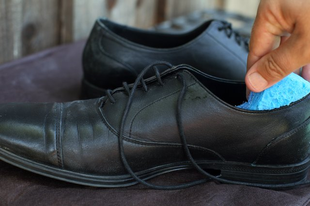 Dip A Sponge In The Vinegar And Water Solution Squeeze It Gently To Remove Excess Liquid Wipe Insoles With Clean Them