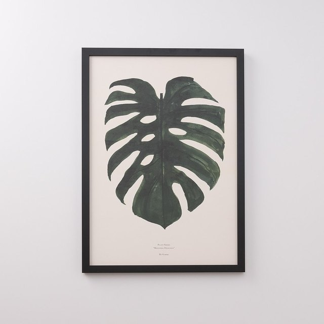 Print of dark green leaf in black frame with cream background
