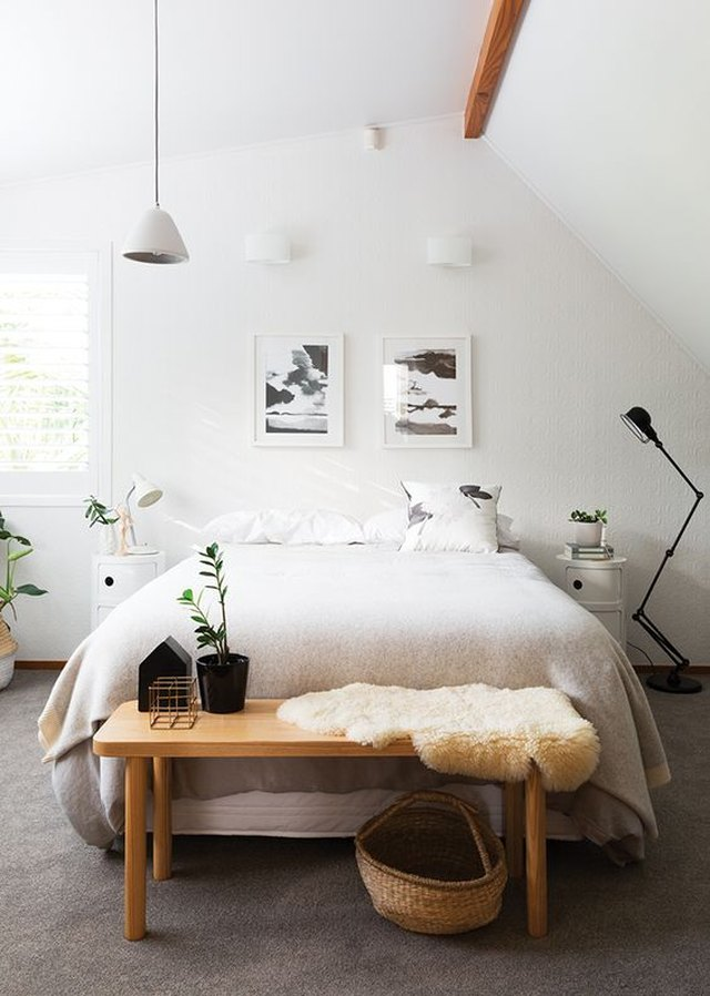 White midcentury bedroom with twin wall sconces above the bed