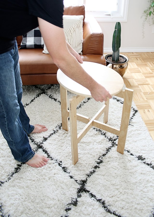 placing the tabletop on the table legs