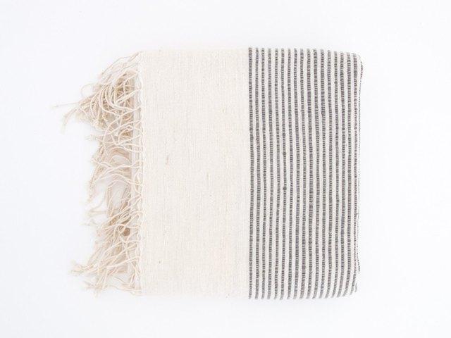 Cream fringed bath towel with fine gray ribbing