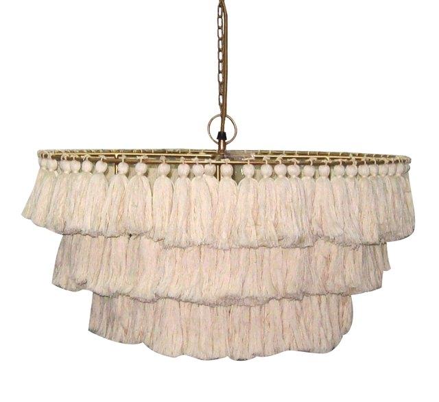 Modern chandelier with cream-colored tassels