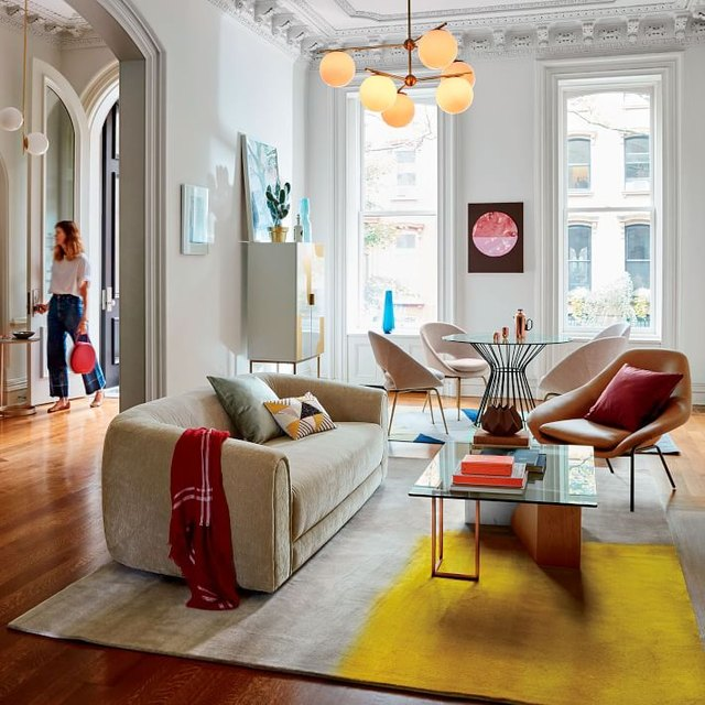 Colorful living room featuring lots of rounded furniture